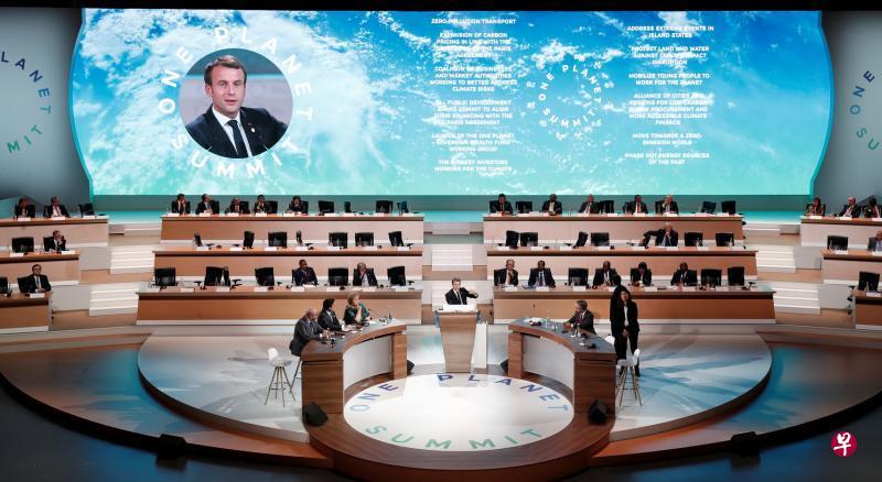 法国总统马克龙在气候峰会上呼吁国际社会加速行动,让全球暖化斗争迈入一个新阶段。(路透社).jpg